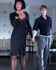 Tempting sissy in a black dress and Cleopatra wig pleasures a horny gay boy