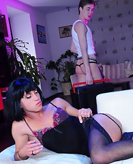 Feminized seductress clad in a dress and stockings opens up her sissy butt